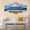 A Shinkansen bullet train passes below Mt. Fuji in Japan, Wall Art