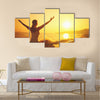 Yoga at sunset on the beach woman doing yoga performing Multi panel canvas wall art