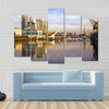 Scene Of A Lake Flowing In Front Of Yellow Building Multi Panel Canvas Wall Art
