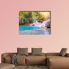 Waterfall in rain forest with rainbow Tat Kuang Si Waterfalls canvas wall art