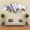 Woman and man having fun in volley ball game in summer Multi panel canvas wall art