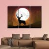 Silhouette of a deer standing on a hill at night multi panel canvas wall art