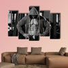 Portrait of a Physically fit Man in Hoodie Showing His Six Pack wall art