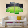 Grass tennis court and stadium full of spectators Multi panel canvas wall art
