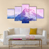 Beautiful cloudy sunrise in the mountains with snow ridge Multi panel canvas wall art