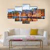 Night city view of Amsterdam, the Netherlands with Amstel river Multi panel canvas wall art