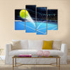 Flying tennis ball on a blue court Multi panel canvas wall art