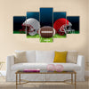 An American football stadium with helmets Multi panel canvas wall art