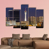 Stormy night sky behind the Stratosphere and Fontainebleau towers on the Las Vegas Strip Multi panel canvas wall art