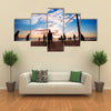 Beach volleyball silhouette at sunset Multi panel canvas wall art