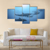 Row of beautiful dolphins swimming view under the water in the ocean multi panel canvas wall art