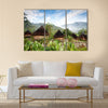 A traditional hut in an Indonesian mountain village Multi panel canvas wall art