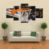 Basketball rim in focus with a glass backboard Multi panel canvas wall art