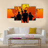 Silhouette of military soldier or officer with weapons at sunset. shot, holding gun, colorful sky, background Multi Panel Canvas Wall Art