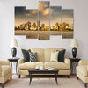 City in the setting sun Multi Panel Canvas Wall Art