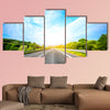 Highway outside the city at sunset multi panel canvas wall art