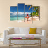 Carefree, Young woman relaxing on the Islands beach Multi Panel Canvas Wall Art
