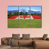 Canada flag done in red and white begonia flower against a backdrop wall art