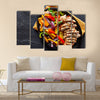 Mexican grilled chicken fajitas in iron skillet shot from overhead on slate Multi panel canvas wall art