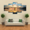 Sun Surfer A Man Is Walking With A Surf In His Hands Across The Sea Shore Multi Panel Canvas Wall Art