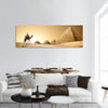 Bedouin on camel near pyramids in desert panoramic canvas wall art