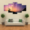 Romantic couple standing together holding hands in the mountains multi panel canvas wall art
