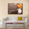 Coffee cup and fresh baked croissants on wooden background Multi Panel Canvas Wall Art