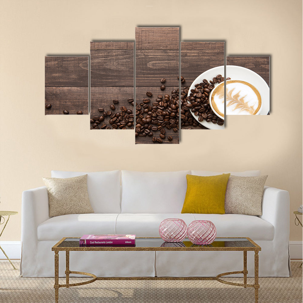 Coffee cup and coffee beans on wooden background Multi Panel Canvas Wall Art