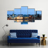 Beautiful reflection of the cityscape of Reykjavik in Lake Tjornin at the blue hour in winter Multi Panel Canvas Wall Art