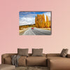 Autumn landscape with road and red car, New Zealand Multi panel canvas wall art