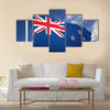 Waving flag of New Zealand on flagpole, on blue sky background Multi panel canvas wall art