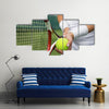 Tennis player holding racket and ball in hands Multi panel canvas wall art