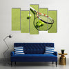 Tennis racket and balls on the court grass Multi panel canvas wall art