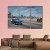 Classic american car drive on Malecon sea front promenade canvas wall art