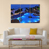 Resort by the Caribbean sea at night Multi panel canvas wall art
