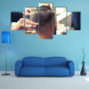 Back view of Man in Barber shop Barber Cutting Hair with Scissors Multi Panel Canvas Wall Art