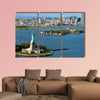 An aerial view from a helicopter of the Statue in New York multi panel canvas wall art