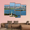 An aerial view from a helicopter of the Statue of Liberty multi panel canvas wall art