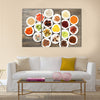 Different products on saucers on wooden table, top view, Multi panel canvas wall art