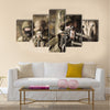 Woman with a rifle in the military Multi Panel Canvas Wall Art