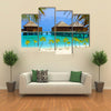 The Water Bungalows On A Tropical Island, Maldives, Multi Panel Canvas Wall Art
