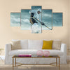 Ice hockey player in action outdoor around mountains Multi panel canvas wall art