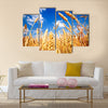 Wheat field and blue sky with clouds Multi panel canvas wall art