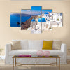 Panoramic scenic view of beautiful white houses and blue domes in Oia, Santorini, Greece Multi Panel Canvas Wall Art