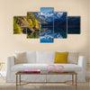 Beautiful view of idyllic colorful autumn scenery with Dachstein mountain Multi panel canvas wall art