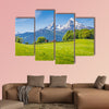 Idyllic landscape in the Alps with fresh green meadows and blooming flowers wall art