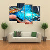 Businessman with modern mobile phone in his hand switching pictures Multi panel canvas wall art