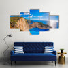 Navagio beach with shipwreck against sunset on Zakynthos Island in Greece Multi Panel Canvas Wall Art