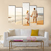 Happy Romantic Middle Aged Couple Enjoying Beautiful Sunset Walk on the Beach, Multi panel canvas wall art