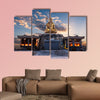 The sun rises behind a Buddha statue in Busan, South Korea multi panel canvas wall art